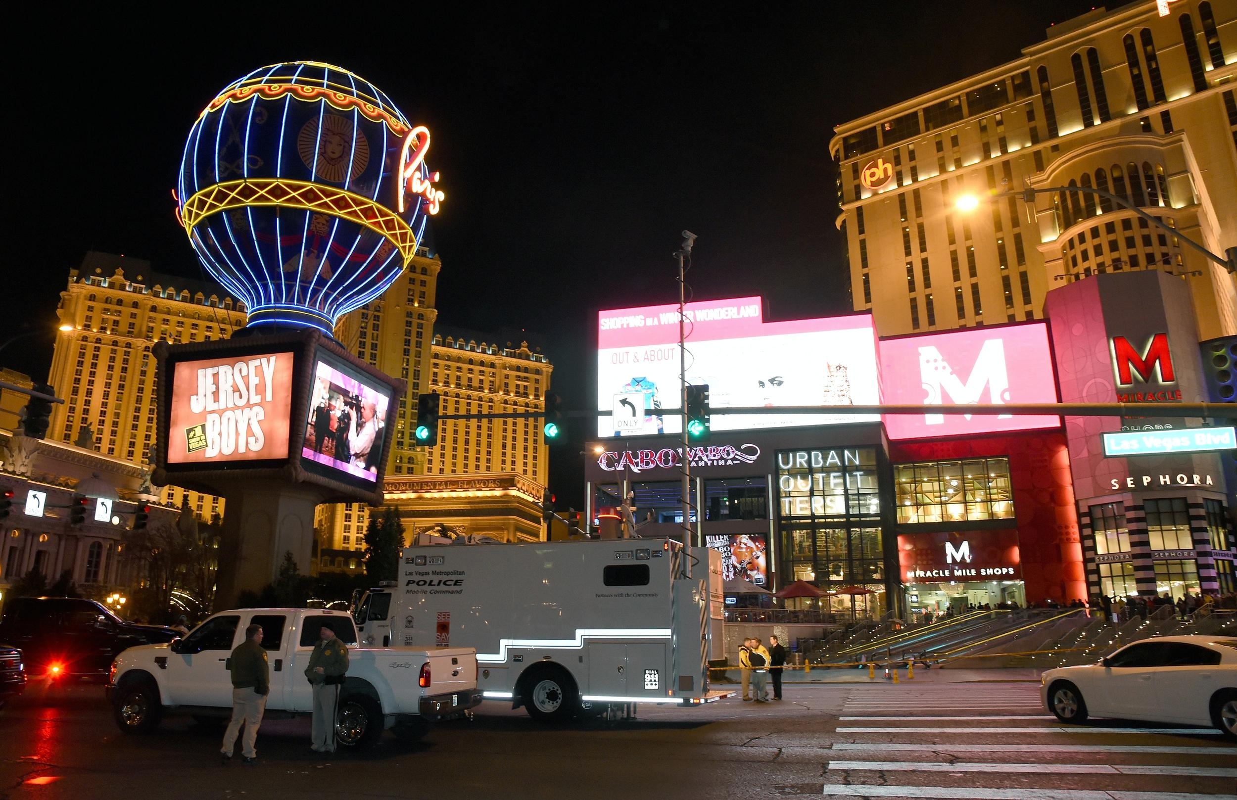 LAS VEGAS, NV - DECEMBER 20:  Police officers stand on the Las Vegas Strip which was closed to all vehicle traffic after a car crashed into a group of pedestrians on the sidewalk in front of the Paris Las Vegas and Planet Hollywood Resort & Casino reportedly injuring at least 35 people and killing one on December 20, 2015 in Las Vegas, Nevada.  (Photo by Ethan Miller/Getty Images)