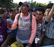A Surge of Migrants Rushes a Mexican Border Crossing