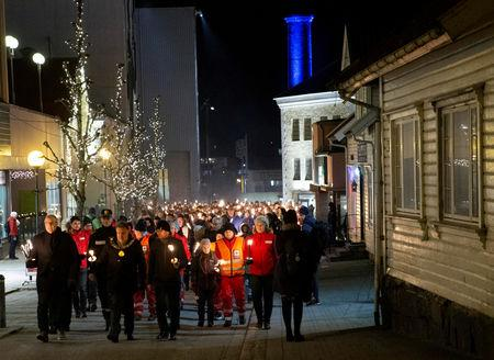 People from Maren Ueland's hometown walk in a torch-lit march to honor Maren Ueland from Norway and Louisa Vesterager Jespersen from Denmark, who were killed in Morocco, in Bryne, Norway, December 21, 2018. Jan Kare Ness/NTB Scanpix/via REUTERS