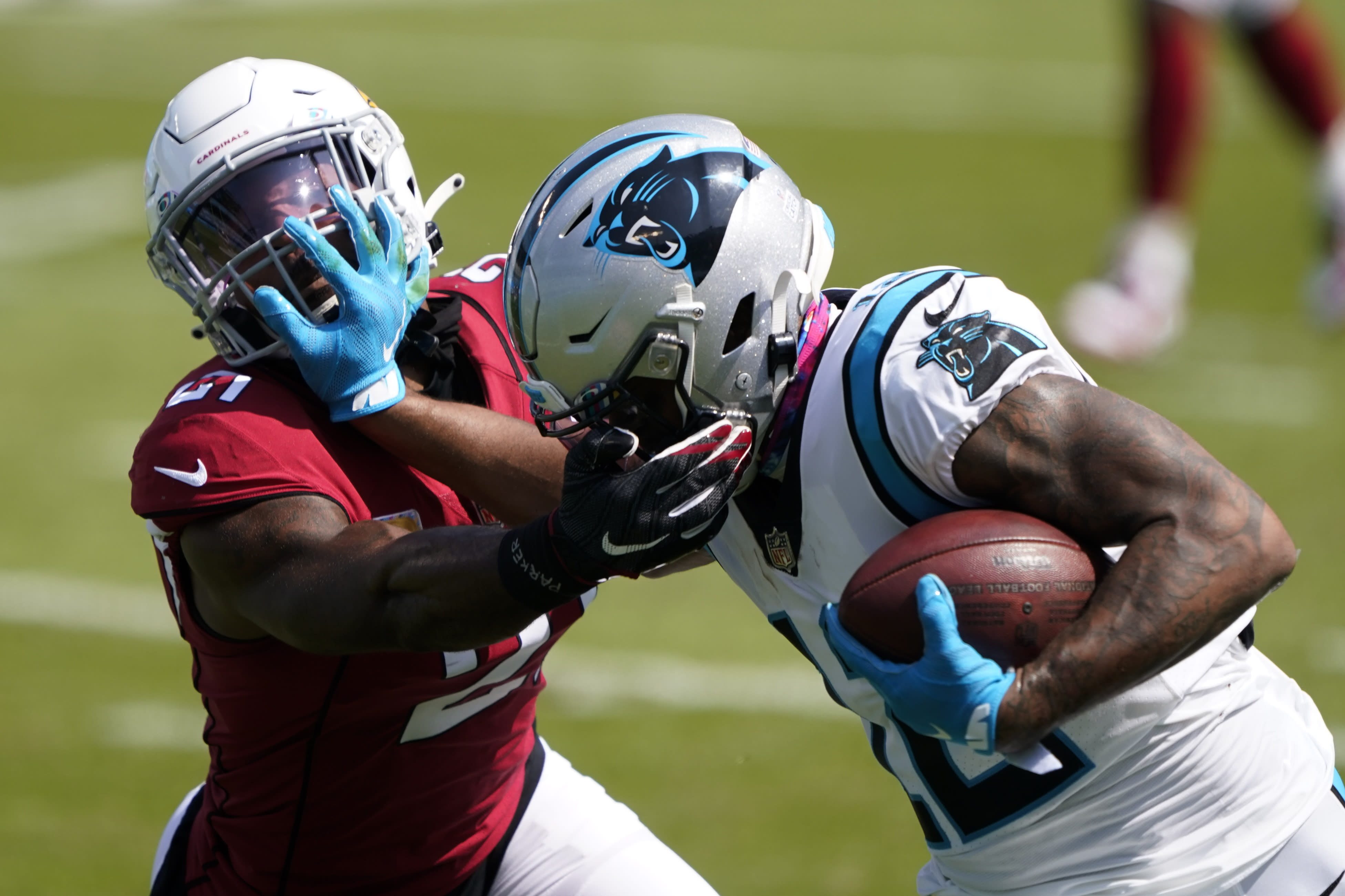 Carolina Panthers wide receiver D.J. Moore pushes way Arizona Cardinals cornerback Patrick Peterson during the first half of an NFL football game Sunday, Oct. 4, 2020, in Charlotte, N.C. (AP Photo/Brian Blanco)