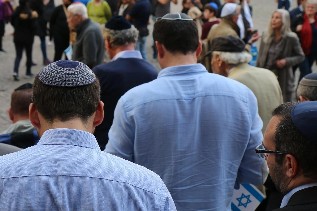 Germans donned the kippa in solidarity demonstrations across the country after an assault on two men wearing the Jewish skullcap (AFP Photo/Yann Schreiber)