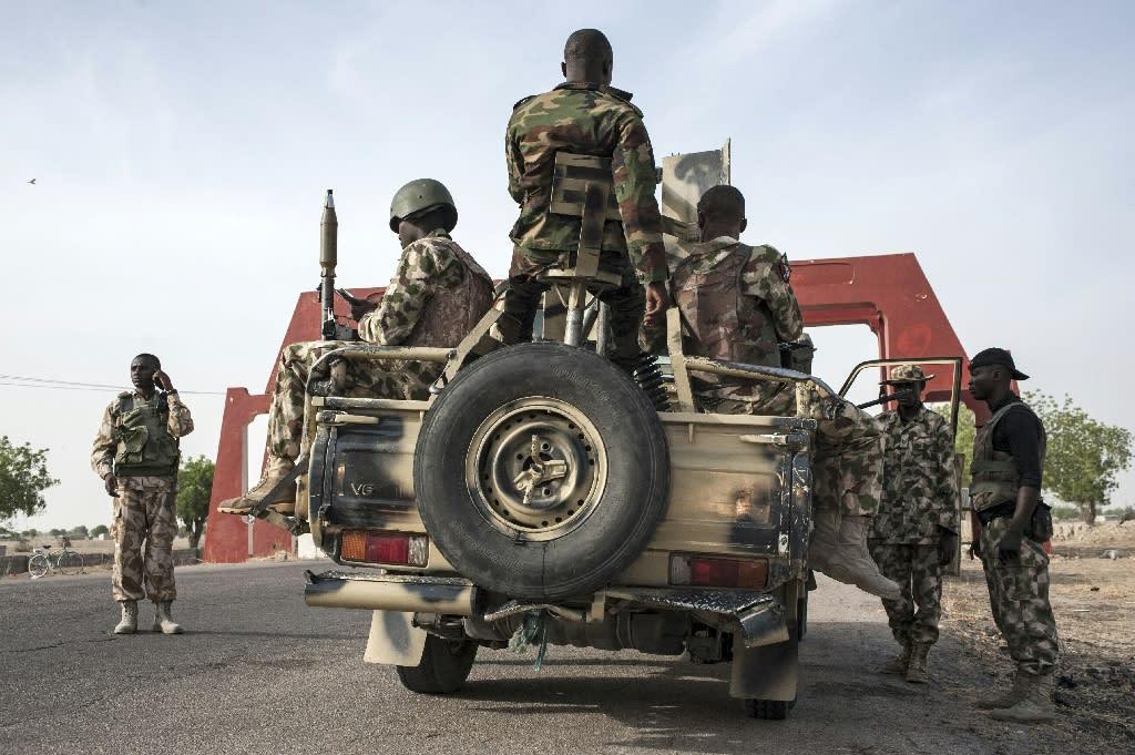 Nigerian soldiers patrol in Maiduguri in Borno State northeast Nigeria on March 25, 2016
