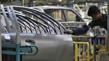Corrected: Auto companies in India cut more jobs, halt production to tackle slowdown