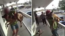 'Piece of s***': Cruel moment woman throws dog off balcony
