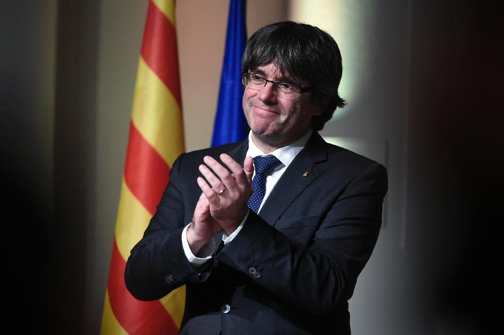 Spain has issued a European arrest warrant for Catalonia's sacked leader Carles Puigdemont (AFP Photo/JOHN THYS )