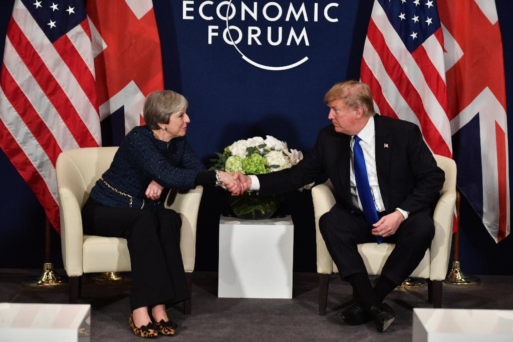 Both US President Donald Trump and Britain's Prime Minister Theresa May will be no-shows this year (AFP Photo/Nicholas Kamm)