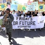 Protected by army men, Afghan youth protest climate change