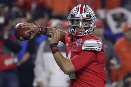 FILE - In this Dec. 28, 2019, file photo, Ohio State quarterback Justin Fields throws a pass against Clemson during the first half of the Fiesta Bowl NCAA college football playoff semifinal in Glendale, Ariz. When Fields got together with some of his teammates last Saturday to watch college football on TV, the mood was dark. Distraught, Fields said. (AP Photo/Rick Scuteri, File)