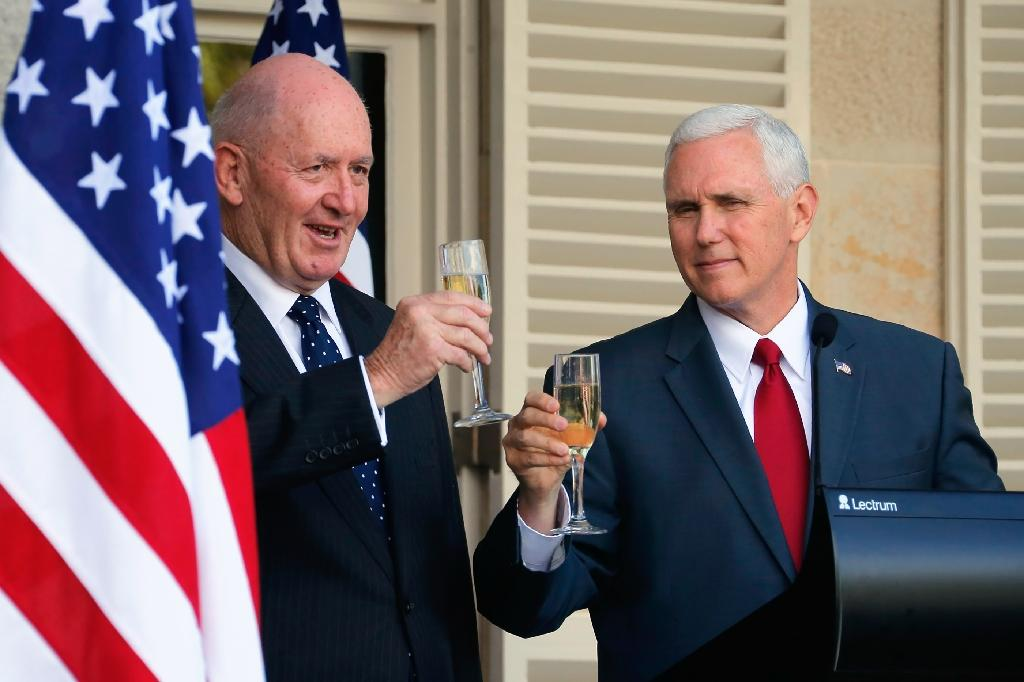 US Vice President Mike Pence (R) and Australia's Governor General Peter Cosgrove toast each other during a lunch reception in Sydney (AFP Photo/JASON REED)