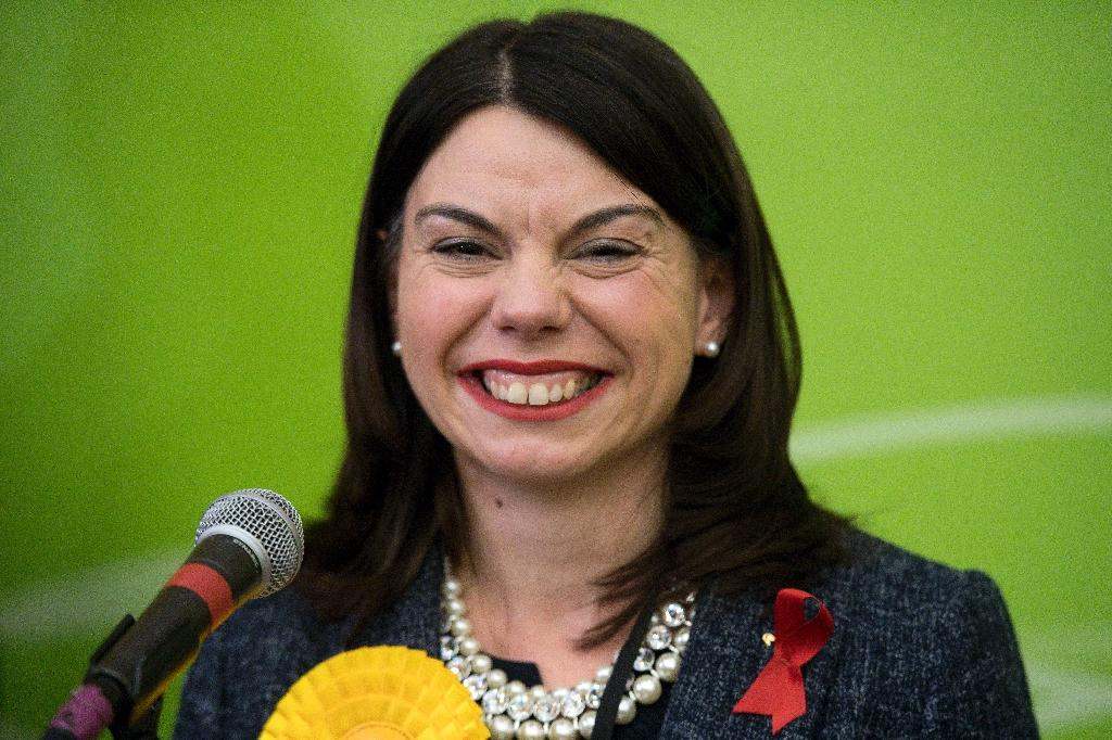 Newly elected Liberal Democrat MP Sarah Olney smiles on stage after winning a by-election in Richmond, southwest London, on December 2, 2016 (AFP Photo/Justin TALLIS)