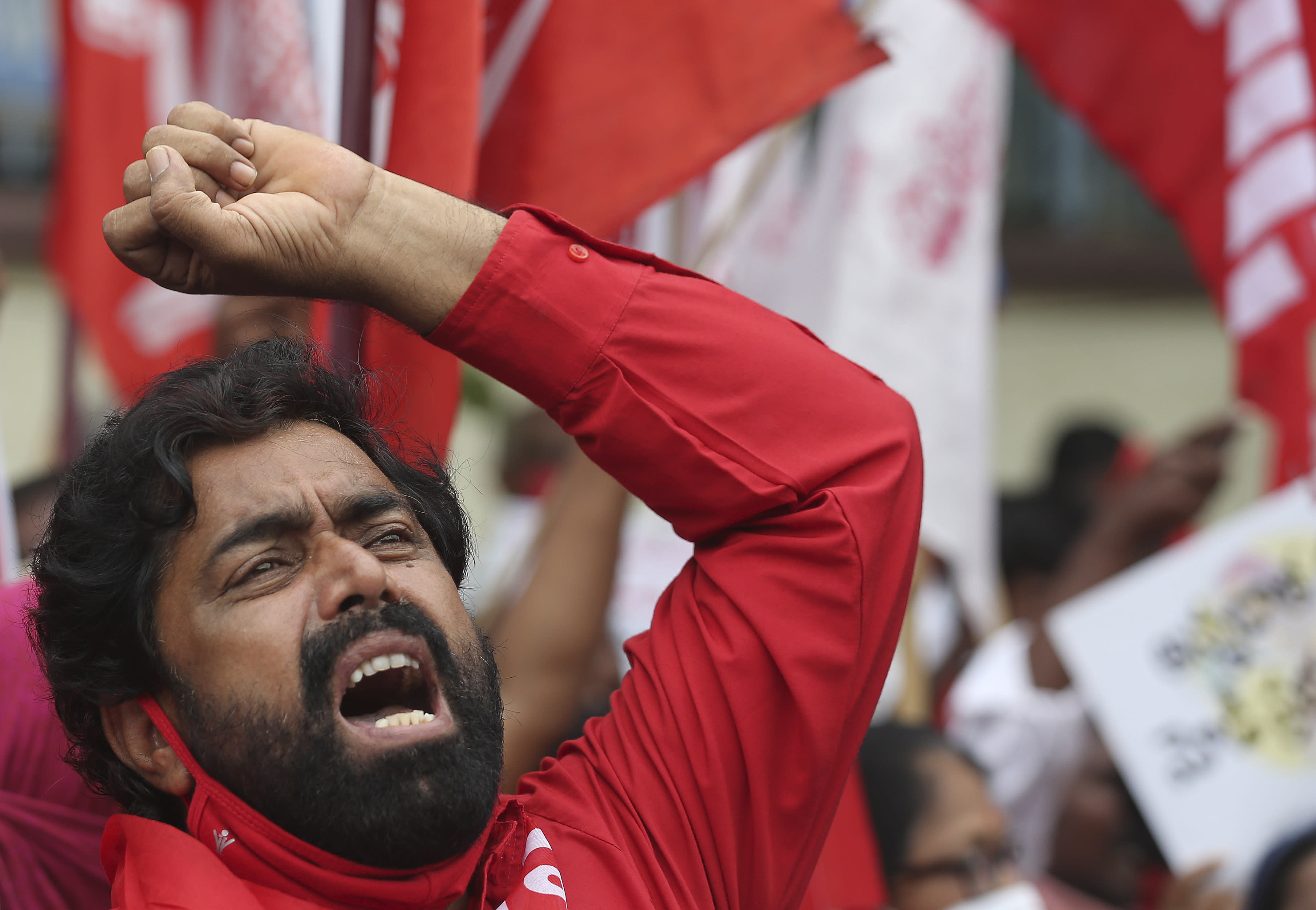 Members of All India Kisan Sangharsh Coordination Committee (AIKSCC) and activists of left parties and trade unions participate in a nationwide protest in Hyderabad, India, Friday, Sept. 25, 2020. Hundreds of Indian farmers took to the streets on Friday protesting new laws that the government says will boost growth in the farming sector through private investments, but they fear these are likely to be exploited by private players for buying their crops cheaply. (AP Photo/Mahesh Kumar A.)