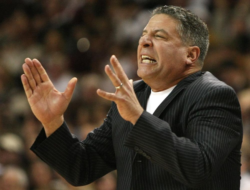 In this March 6, 2010 file photo, Tennessee head coach Bruce Pearl reacts during the second half of an NCAA college basketball game in Starkville, Miss. Auburn has hired former Tennessee coach Pearl to lead a struggling basketball program. The school announced the hiring on Tuesday, March 18, 2014, of the charismatic coach, who remains under a show-cause penalty from the NCAA