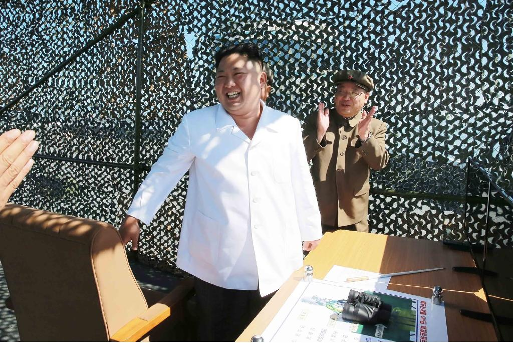 North Korean leader Kim Jong-Un (C) inspects the ground jet test of a new type high-power engine of a carrier rocket, at the Sohae Space Centre, in September 2016 (AFP Photo/KCNA vai KNS)
