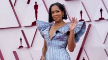 2021 Oscars open with Regina King power walk, George Floyd mention and almost no masks to be seen