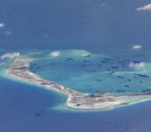 China air force lands bombers on South China Sea island
