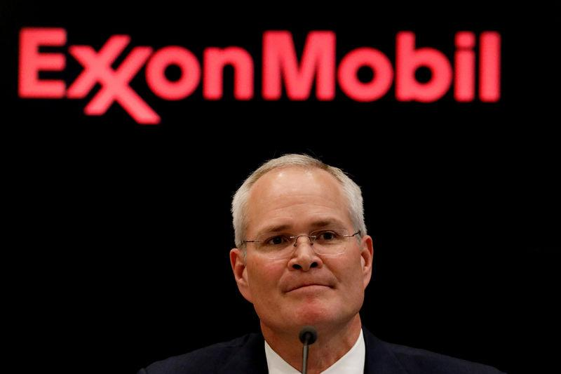 FILE PHOTO: Darren Woods, chairman & CEO, Exxon Mobil Corp, attends a news conference at the NYSE