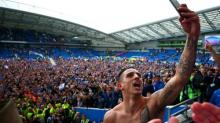 Brighton seal promotion after win over Wigan and Huddersfield draw at Derby