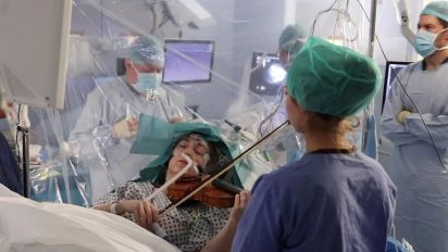Violinist plays instrument during brain surgery