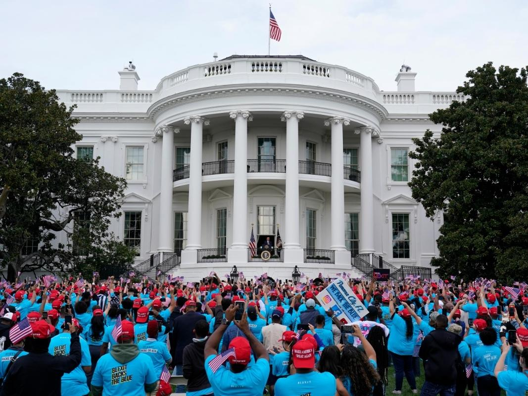 President Donald Trump speaks from the Blue Room Balcony of the White House to a crowd of supporters.