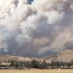 Huge Clouds of Smoke Rise From Growing Apple Fire