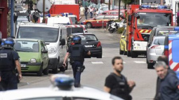Islamists attack French church, slit priest's throat