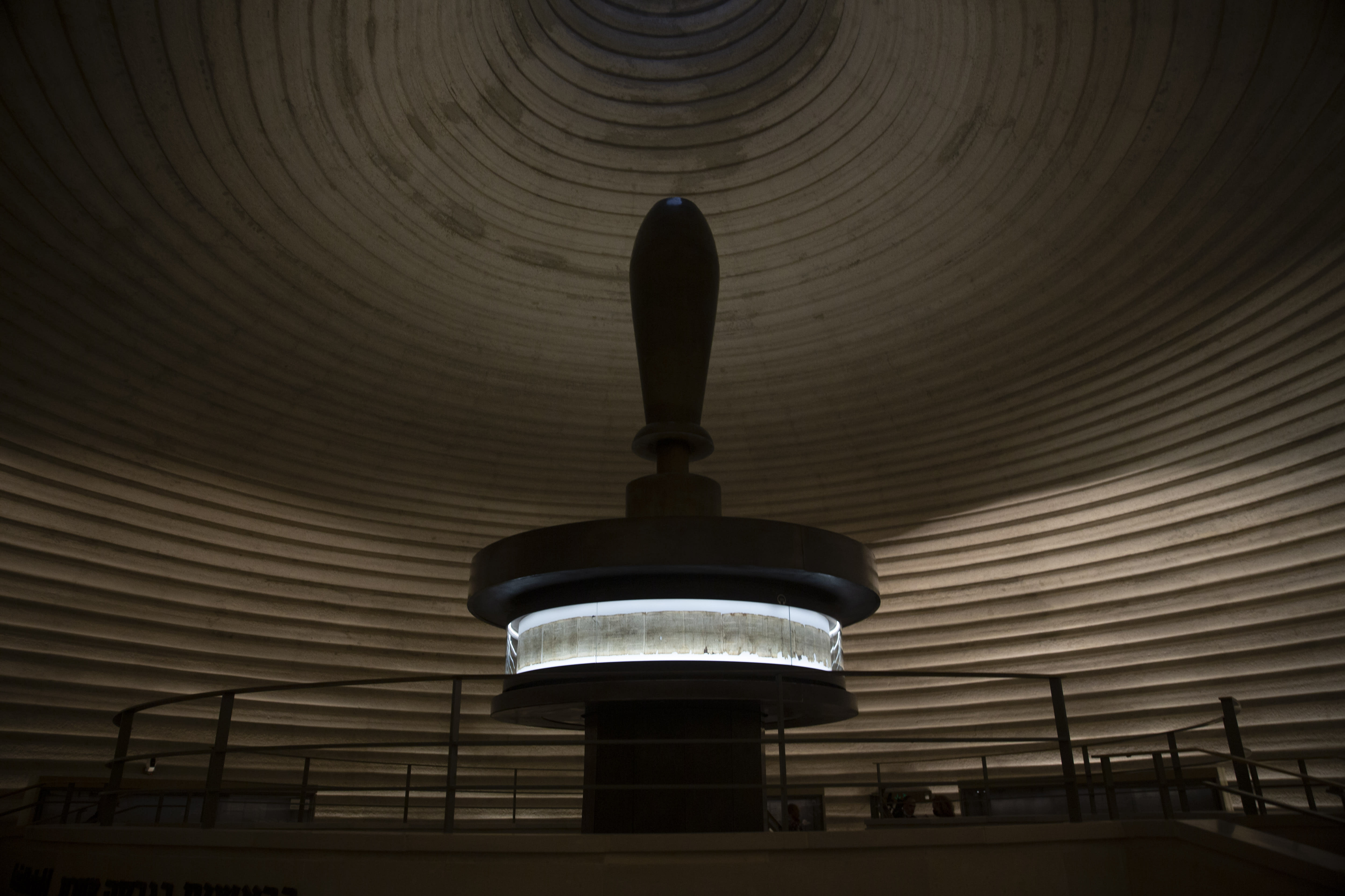 The Dead Sea Scrolls at the Shrine of the Book are on display in the Israel Museum, during final preparations during final preparations to reopen following five months of closure due to the coronavirus pandemic, in Jerusalem, Tuesday, Aug. 11, 2020. The Israel Museum, the country's largest cultural institution, is returning the priceless Dead Sea scrolls and other treasured artworks to its galleries ahead of this week's reopening to the public. (AP Photo/Maya Alleruzzo)