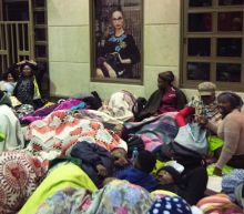 S. African asylum-seekers held on trespassing charges