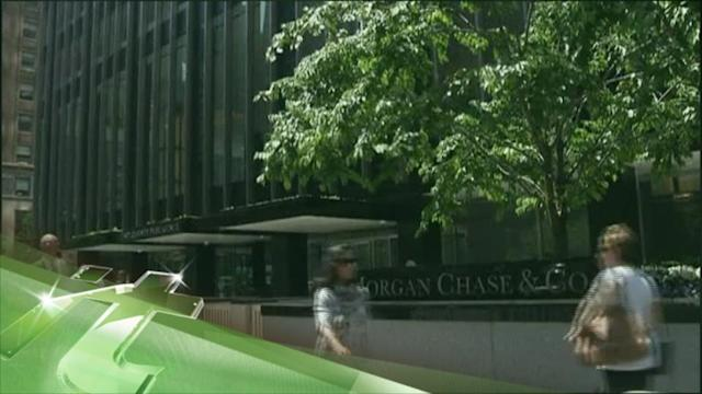 Latest Business News: J.P. Morgan Credit Outlook Cut by S&P