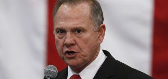 Moore seeks donations, defies calls to concede