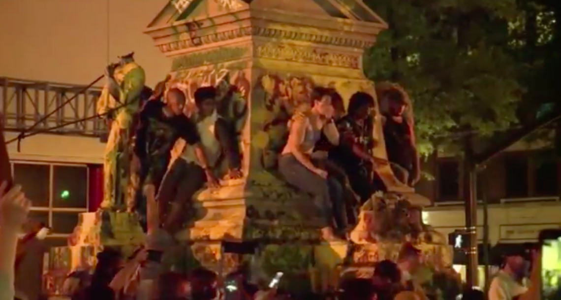Confederate statue toppled by protesters crashes down on man in Virginia, video shows