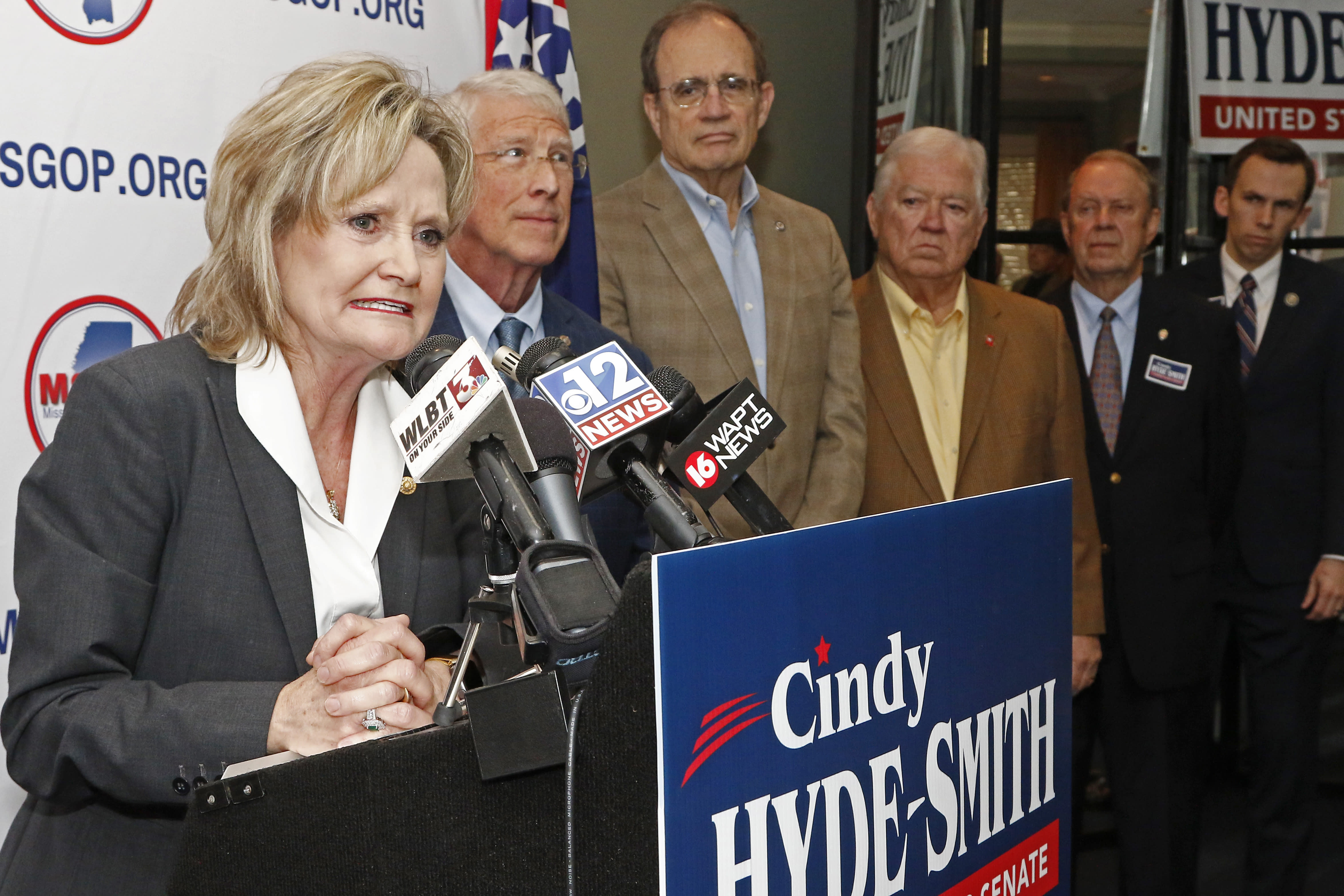 U.S. Sen. Cindy Hyde-Smith, R-Miss., left, thanks fellow Republican U.S. Sen. Roger Wicker, of Mississippi, second from left, Lt. Gov.-elect Delbert Hosemann, center, and former Mississippi Republican Gov. Haley Barbour, for supporting her bid for re-election, Friday, Jan. 3, 2020, at state GOP headquarters in Jackson, Miss. Hyde-Smith filed papers to run at party headquarters, with many Republican elected officials in attendance. She is expected to campaign by emphasizing her loyalty to President Donald Trump. (AP Photo/Rogelio V. Solis)