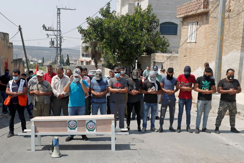 FILE PHOTO: Palestinians protest against normalizing ties with Israel in the occupied West Bank
