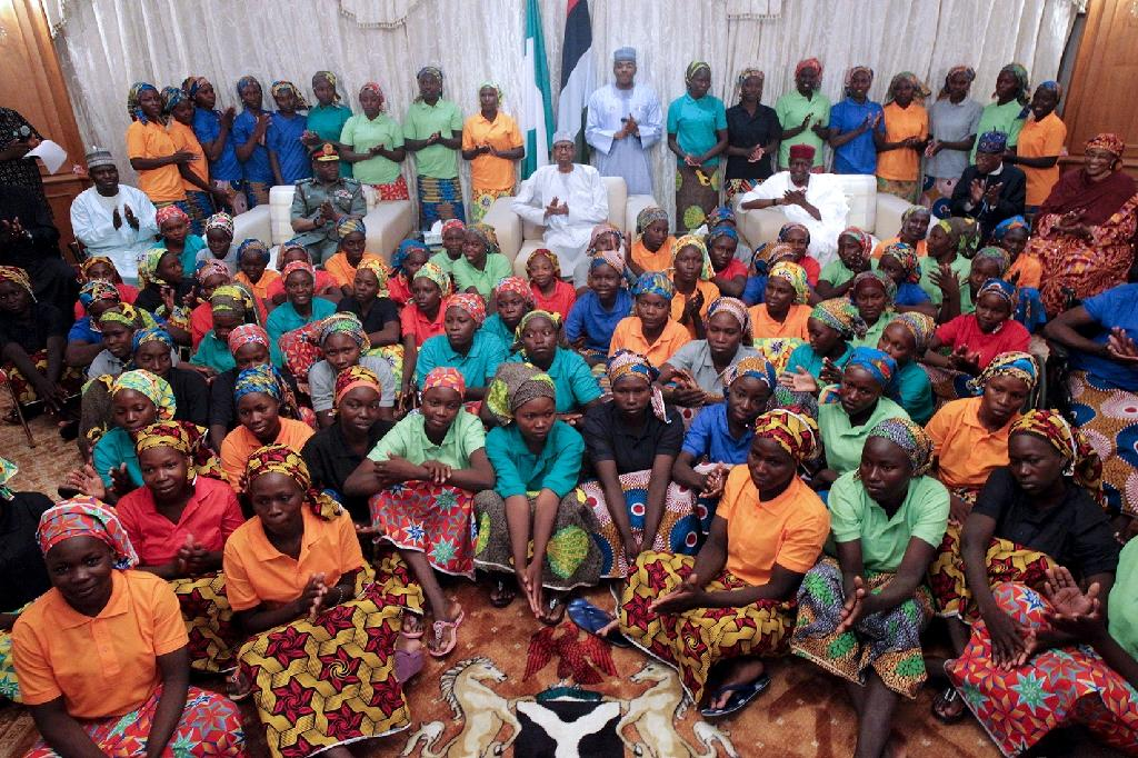 Nigeria's President Muhammadu Buhari (centre) met the 82 rescued Chibok girls after their release in a prisoner swap deal (AFP Photo/Sunday AGHAEZE)
