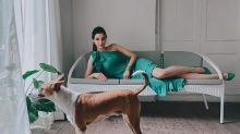 Diana Penty Looks Glam As She Lounges In Her Green Dress While Her Dog Looks Outside The Window