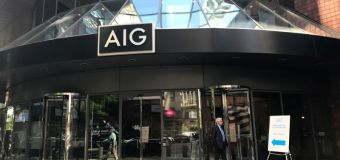 AIG to restructure into 3 new units