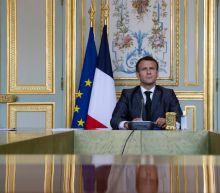 Climate change summit glitch cuts off Macron, puzzles Putin