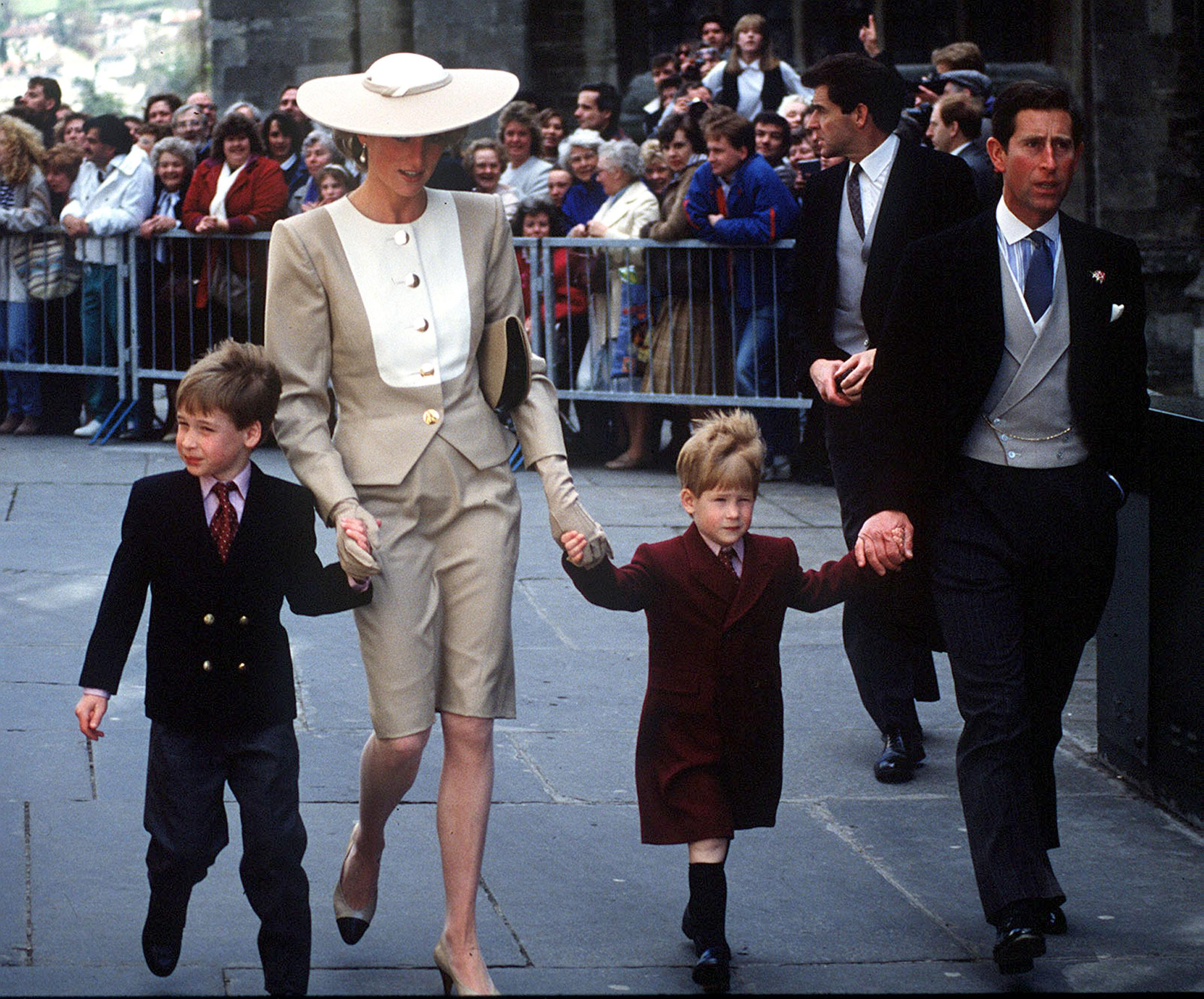 The Prince and Princess of Wales, with young Prince William and Harry at the wedding of Duke Hussey's daughter in Bath, May 1989. (Photo by Anwar Hussein/WireImage)