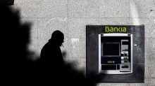 Si la fusión prospera, ¿qué pasará con el dinero que el Estado metió en Bankia?