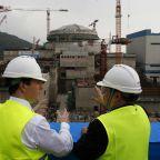 China says nuclear fuel rods damaged, no radiation leak