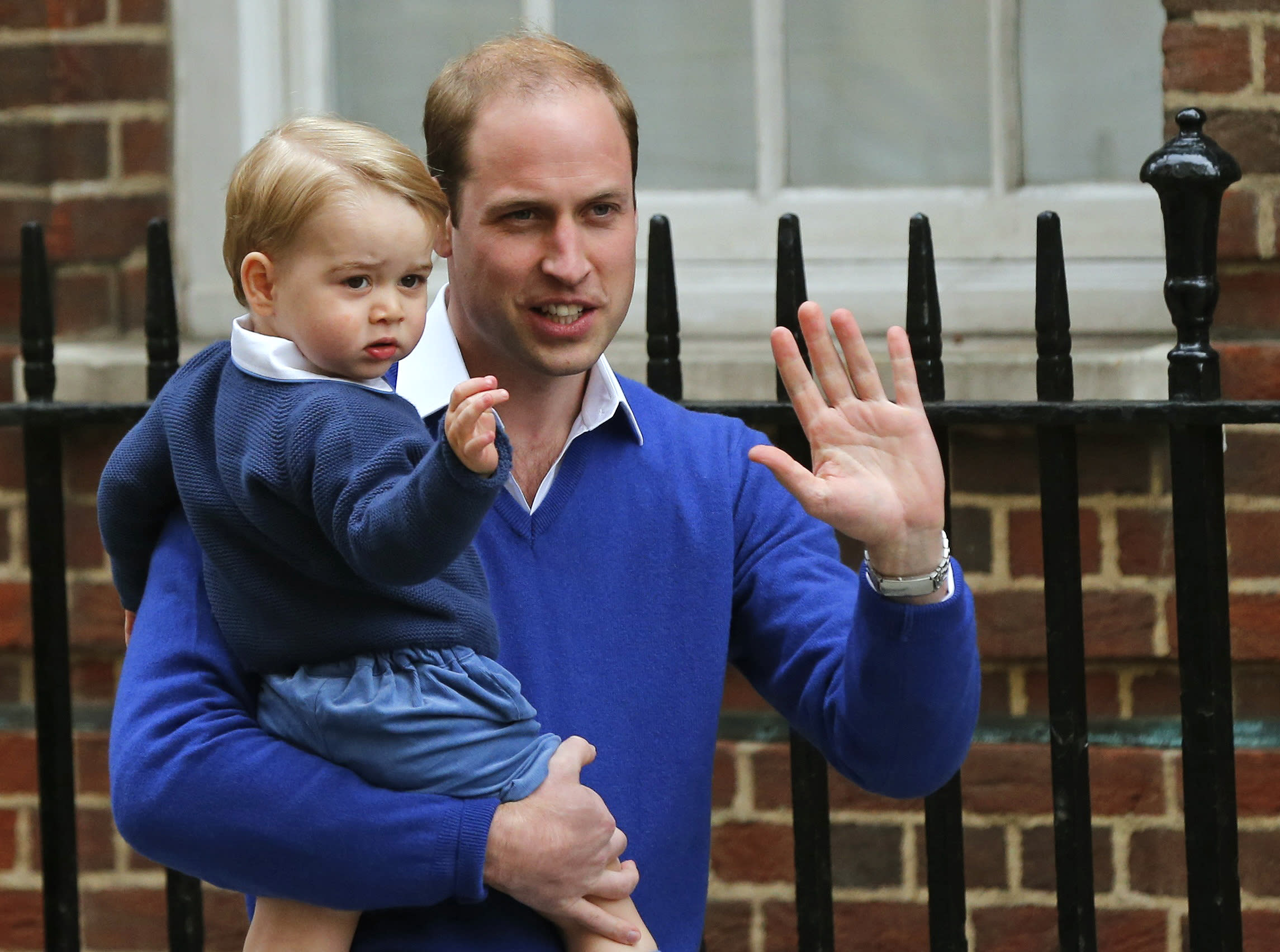Britain's Prince William returns with his son George to the Lindo Wing of St Mary's Hospital, after the birth of his daughter in London, Britain May 2, 2015. Britain's Duchess of Cambridge, has given birth to a daughter, the couple's residence Kensington Palace announced on Saturday.      REUTERS/Suzanne Plunkett