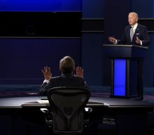 The Latest: Trump plans to debate Biden despite rule changes