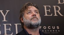 Russell Crowe gives stern warning about climate change in Golden Globes speech delivered by Jennifer Aniston