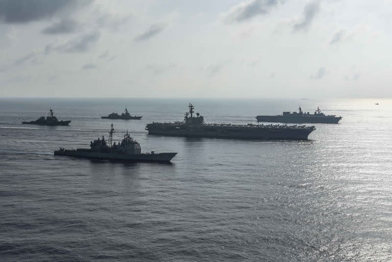 FILE PHOTO: The Ronald Reagan Strike Group ship's aircraft carrier USS Ronald Reagan conduct an exercise with the Japanese Maritime Self-Defense Force ships