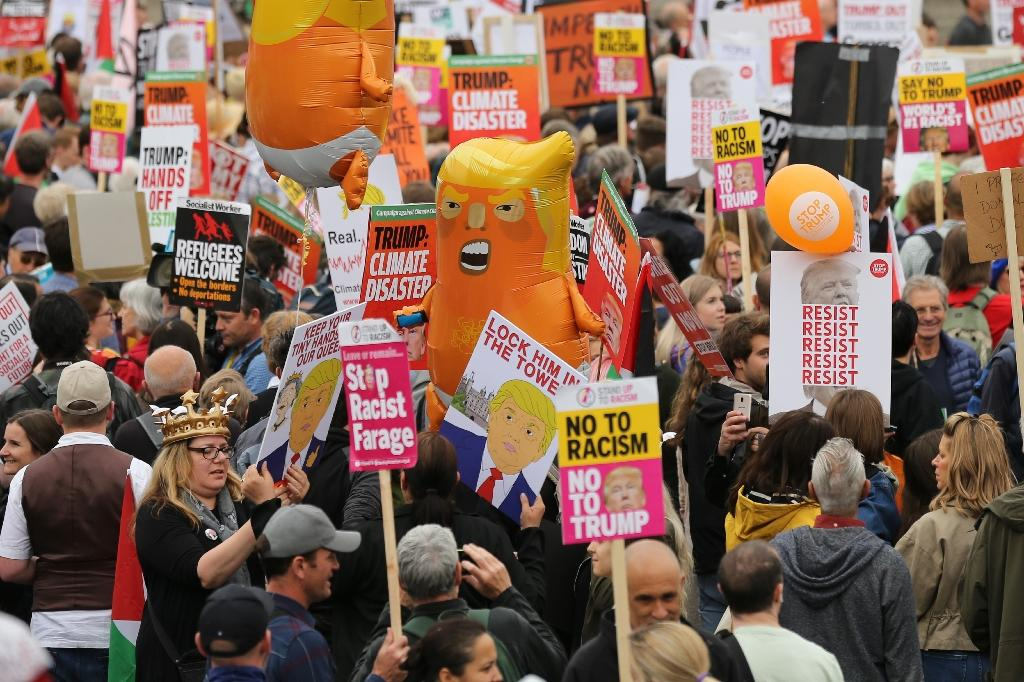 """Crowds gathered under the shadow of Nelson's Column in Trafalgar Square for the """"Carnival of Resistance"""" (AFP Photo/ISABEL INFANTES)"""