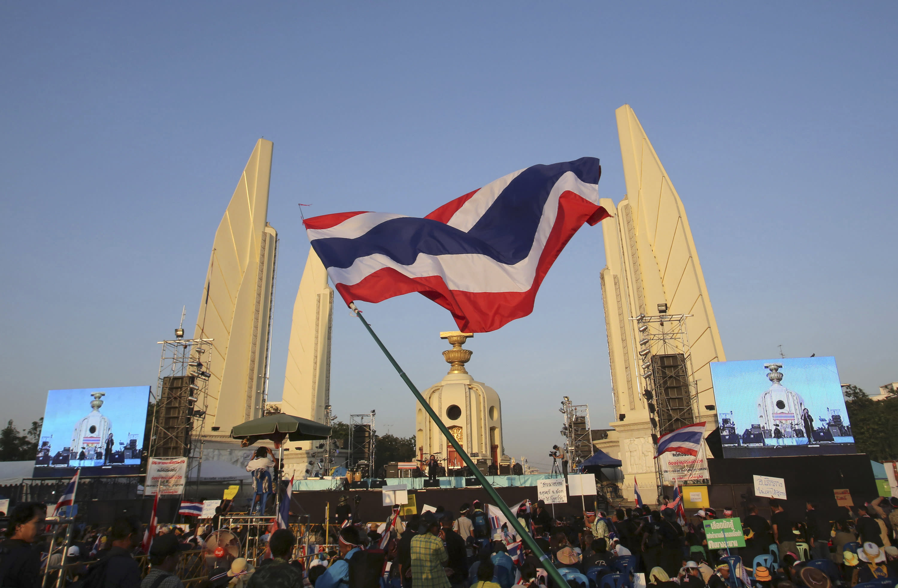 Anti-government protesters gather in front of the Democracy Monument during a rally in Bangkok, Thailand, Sunday, Dec. 1, 2013. 2013. Aggressive political protests in the Thai capital turned violent late Saturday with at least one man killed and several wounded by gunshots in street fighting between supporters and opponents of Prime Minister Yingluck Shinawatra. (AP Phoito/Sakchai Lalit)