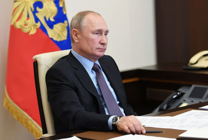 Russia's President Putin takes part in a video conference call outside Moscow