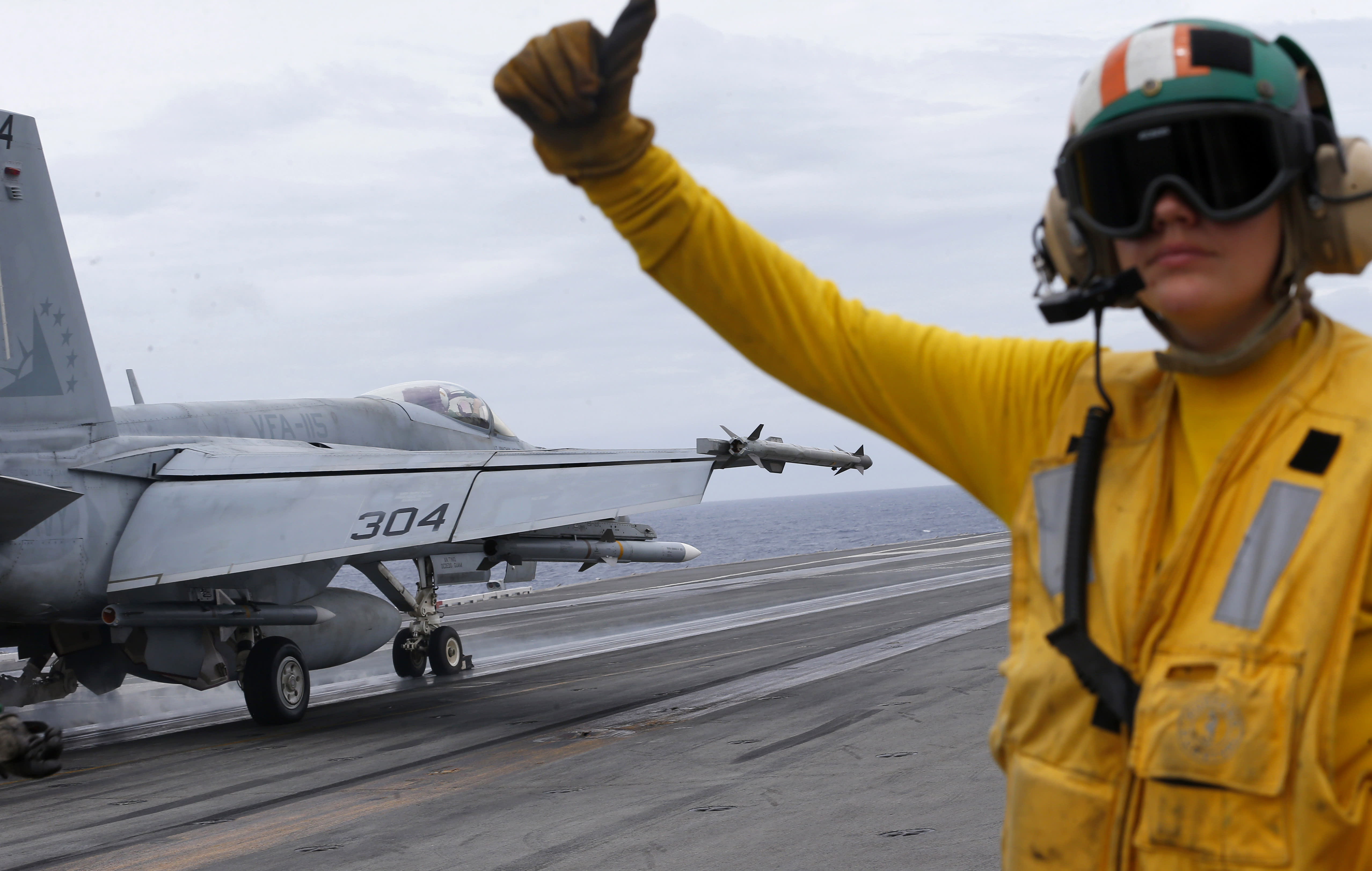 A U.S. fighter jet takes off from the U.S. aircraft carrier USS Ronald Reagan for their patrol at the international waters off South China Sea Tuesday, Aug. 6, 2019. The U.S. aircraft carrier has sailed through the disputed South China Sea in the latest show of America's military might amid new territorial flareups involving China and three rival claimant states as Philippines, Vietnam and Malaysia. (AP Photo/Bullit Marquez)