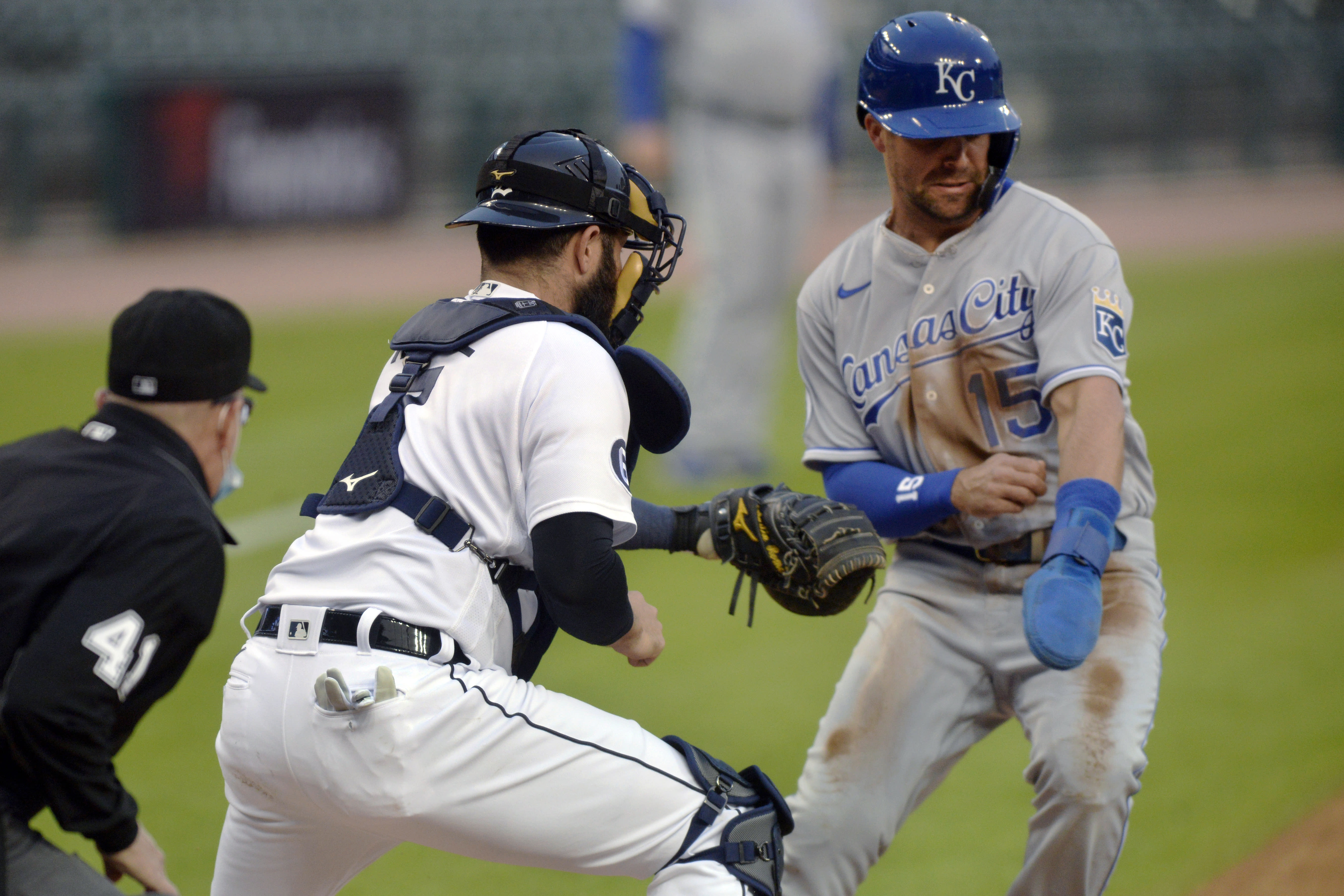 Detroit Tigers catcher Austin Romine tags out Kansas City Royals' Whit Merrifield during the first inning of a baseball game Tuesday, Sept. 15, 2020, in Detroit. (AP Photo/Jose Juarez)