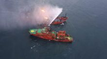 At least 10 dead as fire rages on Black Sea ships