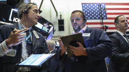 Stocks slide as investors digest earnings, await Fed